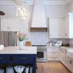 White Pecky Cypress Kitchen Cabinets with Navy Blue Island