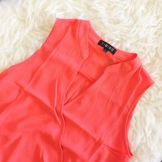 | new | peach wrap top Sleeveless v-neck wrap top.  97% Polyester 3% Spandex Tops Blouses