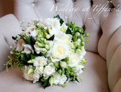 Ivory roses, snap dragons & freesia, unstructured, rustic look for this bridal bouquet designed by Tiffany's flowers
