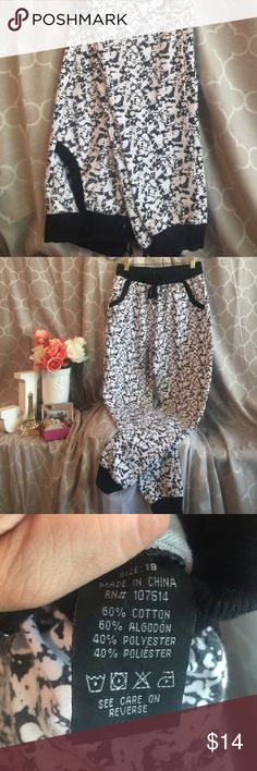 unisex black and white color splash joggers Stylish unisex colored splash black and white with pockets joggers. With string to tie to adjust waist & elastic waist. Size 18 in youth. Made from 60%cotton/40% polyester. joggers Pants Track Pants & Joggers