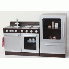 - This Stylish Gourmet Espresso Toy Kitchen Set consists of a standalone toy kitchen and matching toy fridge. The standalone toy kitchen consists of a 4 burner cooktop, oven, sink and dishwasher. The matching toy Childrens Play Kitchen, Kids Toy Kitchen, Pretend Play Kitchen, Kitchen Stove, Kitchen Appliances, Kitchens, Plywood Storage, Cooking Toys, Kids Bedroom Furniture