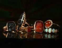 1880s Bloodstone Cameo Ring, 10K, (sold)  1900s Navette Shaped Agate Ring, 10K, (sold)  1860s Faith Hope & Charity Intaglio Ring, Carnelian, 10K (sold)  1890s Carnelian Glass Cameo Ring, 10K, $250  1880s Carnelian and Rose Cut Diamond Ring, 14K, (sold)  1900s Five Opal Ring, 10K, (sold)