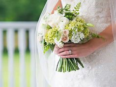 Corey created this hand tied bouquet of creams, greens, and small hints of blush for Monica. The Sonnet House weddings   Photos: His Hands Photography