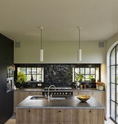 Designed by timeless Living. Steel windows and black Moroccan zelliges