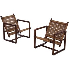 Pair of French Woven Rush Lounge Chairs, 1960 | From a unique collection of antique and modern lounge chairs at https://www.1stdibs.com/furniture/seating/lounge-chairs/