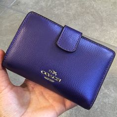 Authentic Purple coach zip wallet F53436 Never used. Gorgeous grain leather zip wallet Seven credit card and multifunction pockets Full-length bill compartments Zip coin pocket Measures: 5 1/4 (L) x 3 1/2 (H) Coach Medium Crossgrain Leather Zip Wallet Style: #F53436 Color: Iris/purple Coach Bags Wallets