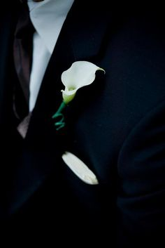 Classic white calla lily boutonniere for Christopher...I've always loved this for the groom. He will match my dress & it always looks great in the pics against the dark suit.