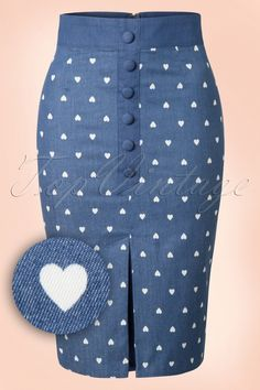 This 50s Judy Hearts Pencil Skirt makes our hearts skip a beat!This cutie features a row of faux buttons, an eyecatching kickpleat at the front and a lovely white hearts print... love at first sight! Made from a denim blue cotton blend (doesn't stretch!) which hugs your curves perfectly.Judy, our hearts aren't complete without you!   Row of faux buttons Kickpleat at the front Faux pockets at the back Slit at the back Hidden zipper and hook closure at the back Hits ...