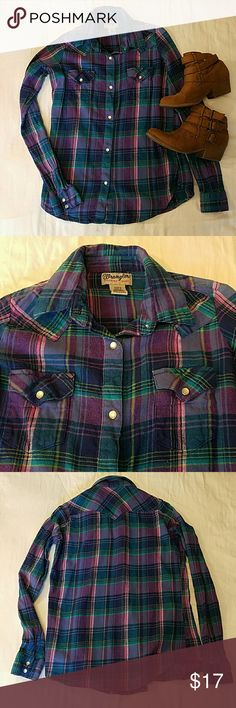 Wrangler Snap Button Western Flannel New shirt in a bright beautiful purple, blue, green, and pink plaid. Perfect for fall with jeggings and booties! Runs slightly small through shoulders. All of my items come from a smoke-free home. I'M MOVING AND DOWNSIZING CLOSETS... EVERYTHING MUST GO BY 10/15! MAKE ME AN OFFER. Wrangler Tops Button Down Shirts