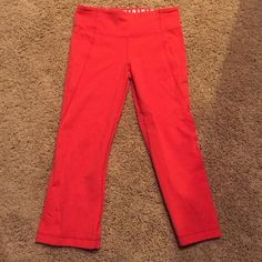 Lululemon crop yoga pants Cute red yogas from lulu! They are capri style with little slits on the back and cute stripes inside the waist band lululemon athletica Pants Ankle & Cropped