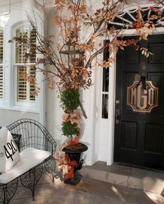 .Mary Carol did it again!  Beautiful door and striking entry.  Very long branches at front door. Love it.