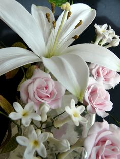 Imgend ... Lilly, Stephanotis and roses  I really like this......
