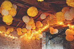 Beautiful yellow pom poms for this Italian barn wedding. Photos by www.lauramccluskeyphotography.com