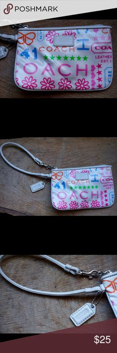"""Coach coated canvas white leather trim wristlet Coach white coated canvas with leather trim wristlet. Exterior is in excellent condition. Pink fabric interior has some minor marks. Measure 6x4"""". Coach Bags Clutches & Wristlets"""