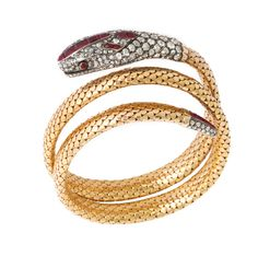 Victorian coiled snake bracelet with gold scaled body, featuring an old-mine diamond and ruby head and tail set in silver, English, ca. 1880