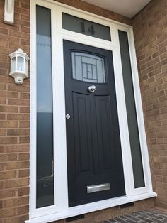 A beautiful Black Newark with Citadel Glass. The black sash and white frame, along with the narrow side panels makes a simple but striking entrance. Front Door Glass Panel, Front Door Entrance, House Entrance, Black Composite Front Door, Black Front Doors, Modern Front Porches, Modern Front Door, Porch Uk, Black Interior Doors