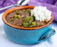 This recipe for Cajun Gumbo with andouille sausage is hearty and comforting. Serve it over rice for awarm and satisfying taste of the Louisiana bayou. Louisiana Gumbo, Cajun Gumbo, Louisiana Recipes, Cajun Recipes, Louisiana Bayou, Donut Recipes, Cooking Recipes, New Orleans Recipes, Sausage Gumbo