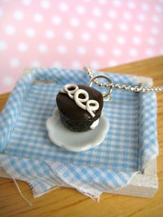 Food Jewelry Cupcake Charm. $8.00, via Etsy. Omgosh this lady's mini polymer clay stuff is freaking adorable