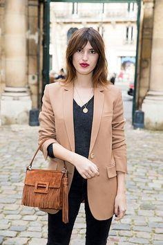 Jeanne Damas on the streets of Paris carrying a Roger Vivier Miss Viv bag.