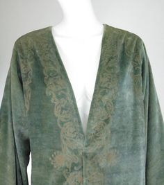 Mariano Fortuny sea green stenciled silk velvet coat early 1900s a shade of sea green is stenciled in gold, real gold power was used…Long full sleeves, v front coat, deep side vents, there are two Venetian glass beads attached with silk cords at the waist, the closure loops at the opposite side are missing...The coat is lined in muted gold silk faille