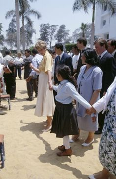 Princess Diana holds the hand of a ten year old polio sufferer, Heba Salah, when she visited the Institute of Polio  Rehabilitation in Cairo, Egypt on May 12, 1992