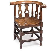 A LATE REGENCY YEW-WOOD CORNER CHAIR  WELSH, MID-19TH CENTURY  Of large scale, the curved moulded toprail above a pierced baluster splat, the dished seat with a further drop-shaped dish over the front leg, on ring-turned legs joined by conforming double-stretchers, the arms with brass caps, the seat possibly conceived with a brass roundel to the front (see below), two splats resupported