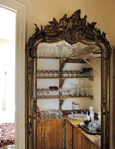 a hidden doorway behind a huge mirror. Sounds like a plan...