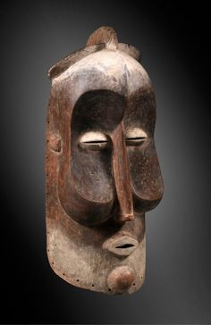 Africa | 'kakuugu' helmet mask from the Suku people of DR Congo | Wood and pigment