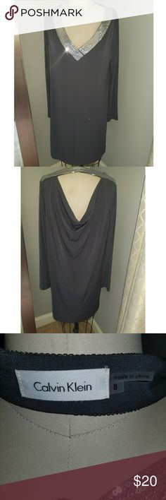Calvin Klein Dress with sequin detail Calvin. Klein gray dress with sequin detail. 95% Polyester 5% spandex. Pics of actual dress are of a size 8 dress on a size 4 dress form. See 1st 2 pics for more better sense of fit. Calvin Klein Dresses Midi