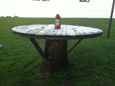 Tree stump table made with large wire spool!