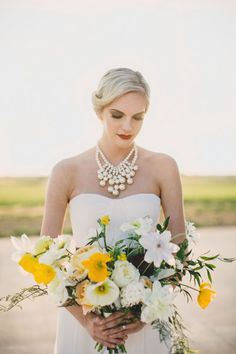 Airplane hangar wedding inspiration | Photo by Whitney Bennett Photography | Read more - http://www.100layercake.com/blog/?p=75974
