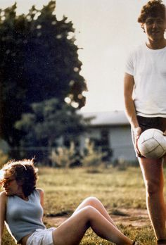 1975:  Bill and Hillary Clinton playing soccer