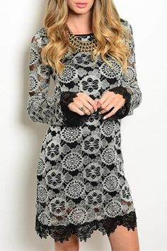 "Long sleeve dress features scalloped trim on hem and cuffs of bell sleeves. Has lace print accent.    Measures: L: 35"" B: 16"" W: 16""    Black Lace Dress by Sage. Clothing - Dresses - Long Sleeve Clothing - Dresses - Printed Texas"