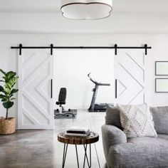 I love a good acid stained concrete floor. It gives a room that cool modern industrial vibe and the best part is that it's way more affordable than other flooring options. Diy Barn Door, Diy Door, Closet Barn Doors, Bedroom Barn Door, Wood Barn Door, Building A Barn Door, Barn Door Hardware, Barn Door Designs, Double Barn Doors