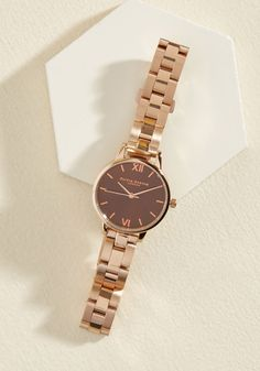 With a final sip of tea, you take a glance at this Olivia Burton Mini Dial watch and glide out the door in style! The brand's classic style shines in this brown and rose gold timepiece, which showcases roman numerals and a linked wristband so you can stay on schedule while looking as sweet as can be.
