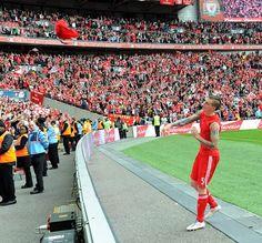 Daniel Agger throws his shirt into the crowd at Wembley