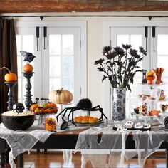 Set a spooky table with ripped cheese cloth.  Come in to Pottery Barn and check out some of these fun Halloween Party ideas.