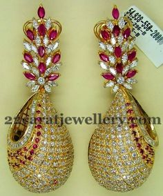 Very classic and trendy designer earrings by Preeti Jain. 18 carat gold earrings top part is comes with floral patterned design, Shell pa...