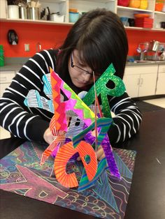 Name sculpture project: each letter can be done in either different color schemes or elements; for 6th grade!
