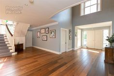 spacious hallway blue and white with dark wood floor Blue Hallway, Dark Wood Floors, Hallway Lighting, Property For Sale, Garage Doors, Blue And White, Flooring, Outdoor Decor, Hallways