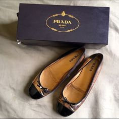 PRADA Ballet Flats PRADA copper flats with black bow. Excellent condition. Very comfortable. Prada Shoes Flats & Loafers