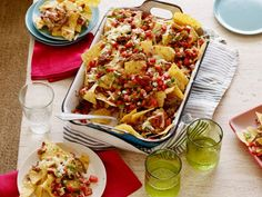 Recipe of the Day: The Pioneer Woman's Cowboy Nachos          The star topping on Ree's impressive nacho platter is tender marinated brisket. Load up on the rest of your favorite fixings, like cheese, beans and sour cream, to complete the dish.            #RecipeOfTheDay