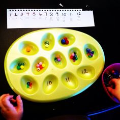 Counting beads with an egg tray...wonderful for my kids w sight issues too.