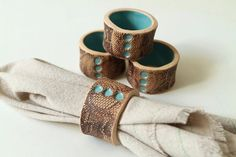 These napkin rings feature a lace imprint on the outside, along with three dots (made by pressing nails into the clay) in the same glossy