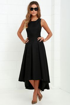When you pass by in the Paso Doble Take Black High-Low Dress, heads will always turn! Take a twirl in this well-constructed sleeveless woven stunner, with princess seams, and open back with top button. Banded waist leads into a pleated high-low skirt. Hidden back zipper with clasp.