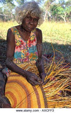 Aboriginal granny Rogie Wudam weaving a traditional pandanus mat Yathalamarra Arnhem Land Australia Stock Photo