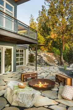 We love the mix of industrial and natural seating by the fire pit!