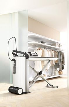The Miele FashionMaster steam ironing system delivers professional results at home and folds away neatly for compact storage
