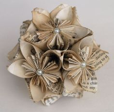 book page flowers - I'd actually like to try to make some of these for my hair...