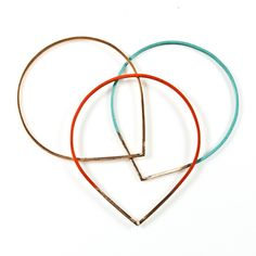 A set of three Raindrop Bangles made in Seattle by Baleen.